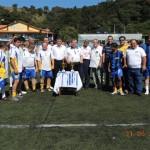 Equipes finalistas e a Mesa de troféus e medalhas